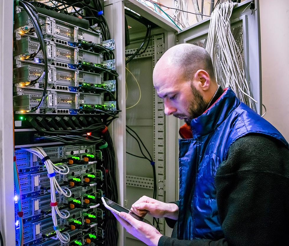 Telecom-providers-engineer-with-servers